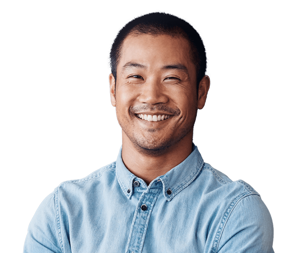 Man smiling in a denim shirt