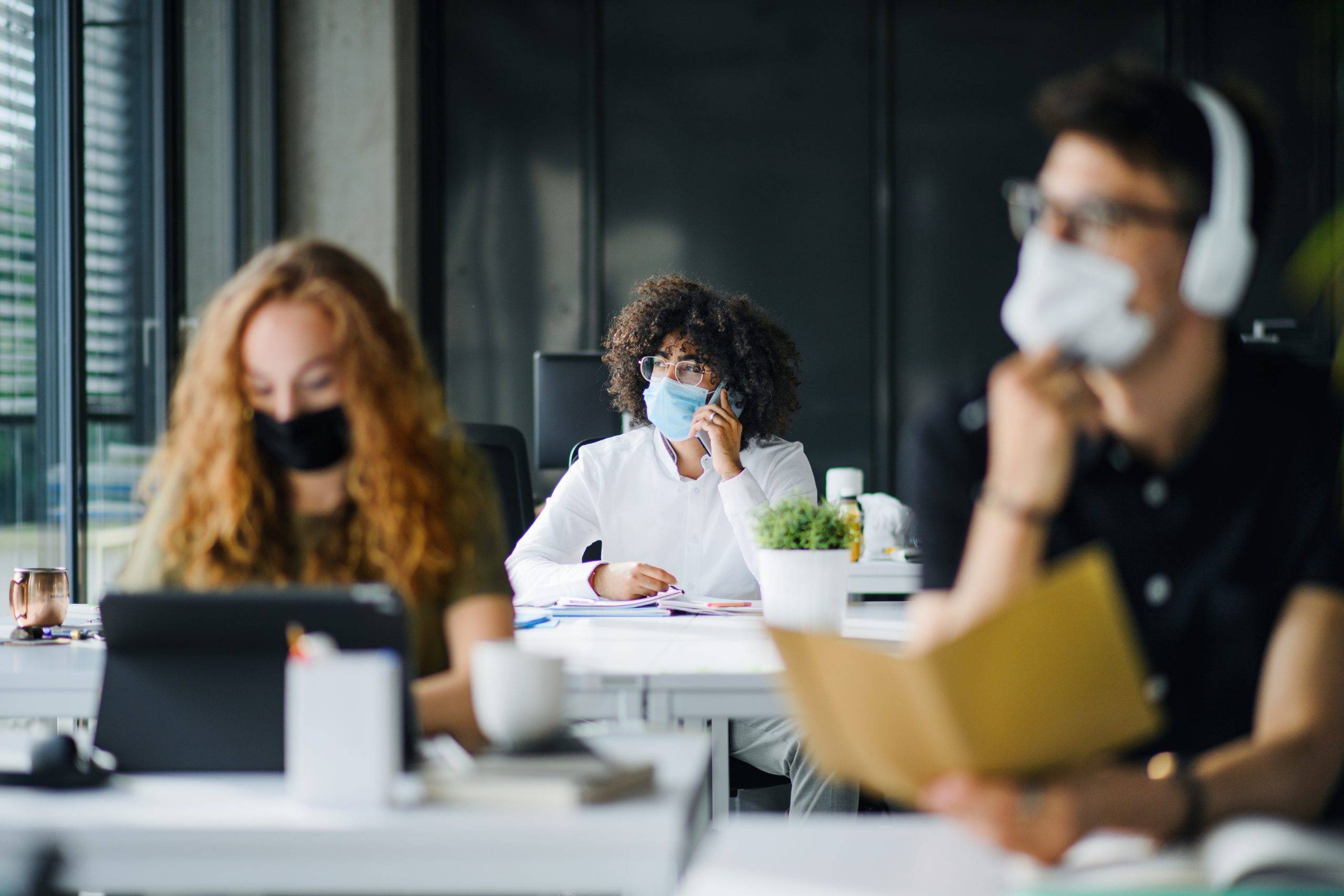 Young,People,With,Face,Masks,Back,At,Work,Or,School